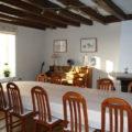 La Bihourderie dining room wooden beams table chairs