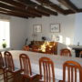 La Bihourderie dining room wooden beams table chairs